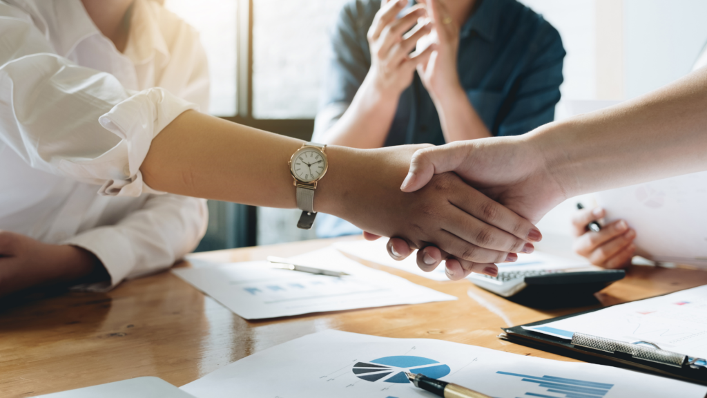 Shaking hands on a deal to acquire a new client